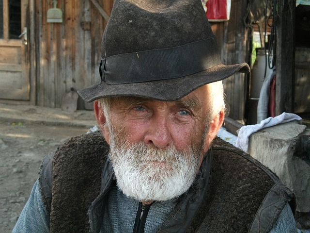 old man white beard black hat